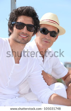 Grandfather and grandson with sunglasses - stock photo