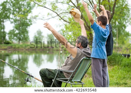 grandfather and grandsons  fishing on weekend - stock photo