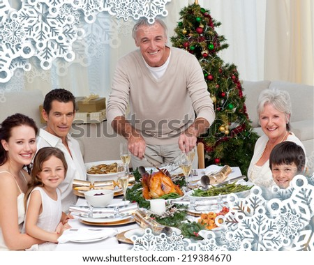 Grandfather cutting turkey for Christmas dinner against snowflake frame