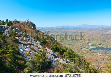 Grandfather Mountain, North Carolina. Tourists climb  the mountaintop to view the North Carolina fall scenery. - stock photo