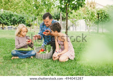 Grandfather Teaching Healthy Eating to Grandchildren