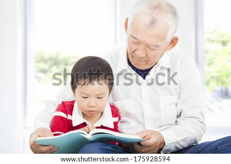 grandfather telling story to his grandson - stock photo
