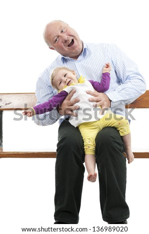 Grandfather with granddaughter making fun, isolated on white background