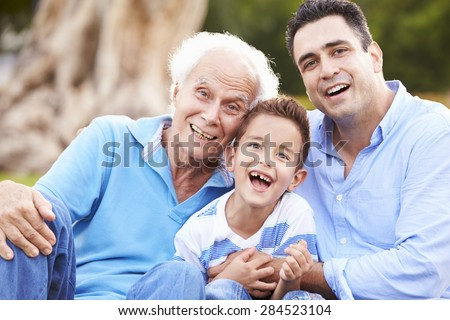 Grandfather With Grandson And Father In Park