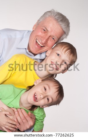 grandfather with his grandsons on a  white