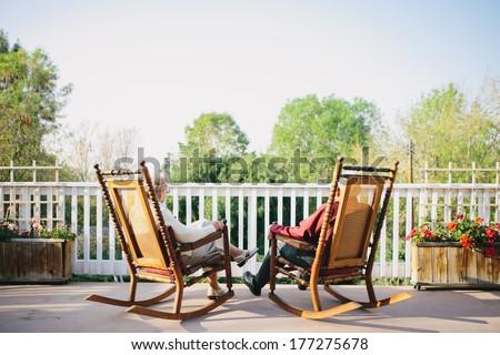 Grandma and Grandpa Sitting on Porch - stock photo