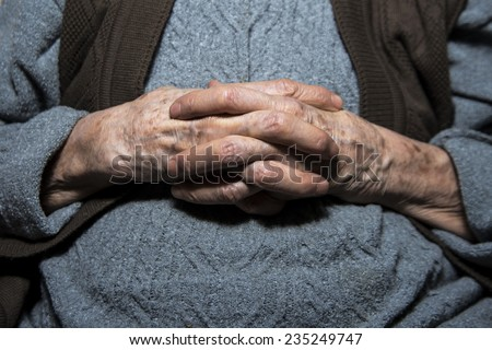 Grandma's old wrinkled hands connected.