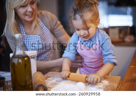 Grandma, this cookie will be for me - stock photo