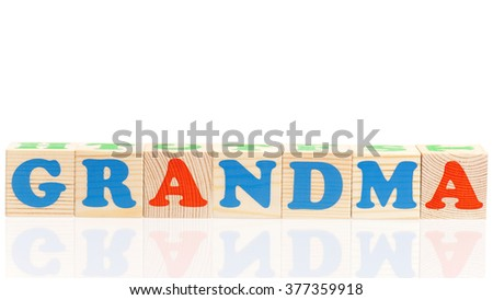 Grandma word formed by colorful wooden alphabet blocks, isolated on white background