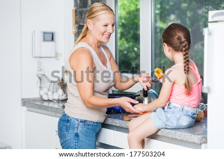 grandmother and child girl cooking at home kitchen, happy smile - stock photo