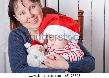 Grandmother and child on Christmas day - stock photo