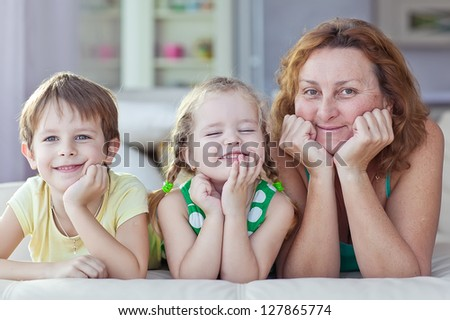 Grandmother and grandchildren at home