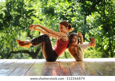 Grandmother and granddaughter at a morning gymnastics - stock photo