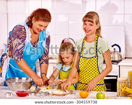Grandmother and granddaughter baking cookies. Family cooking at home
