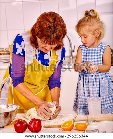 Grandmother and granddaughter baking cookies. Two people. - stock photo