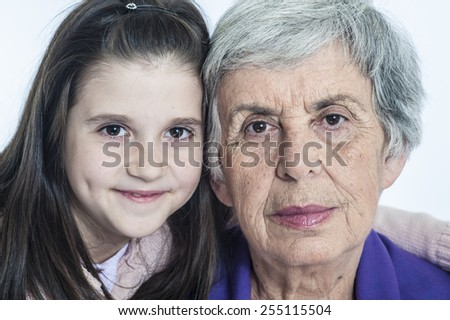 Grandmother and granddaughter beautiful portrait - stock photo