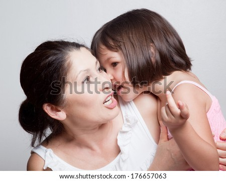 Grandmother and granddaughter gossiping