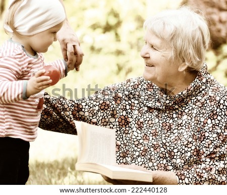 Grandmother and granddaughter. Happy and smilling family. Vintage style. - stock photo