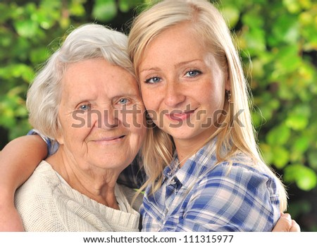 Grandmother and granddaughter. MANY OTHER PHOTOS WITH THIS SENIOR WOMAN IN MY PORTFOLIO.