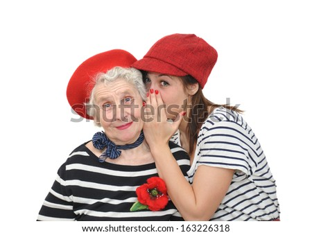 grandmother and granddaughter on white background - stock photo