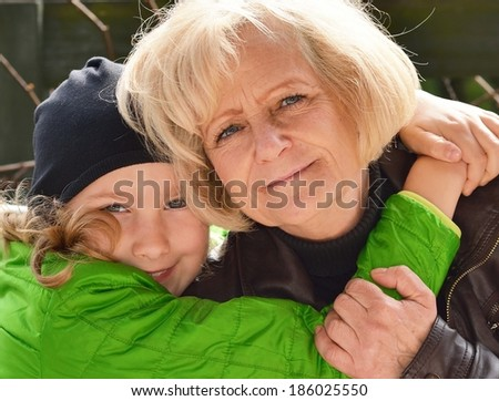 Grandmother and granddaughter, outdoors. - stock photo