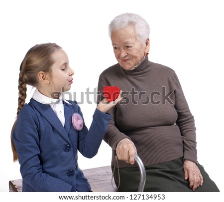 Grandmother and granddaughter with a heart on a white background