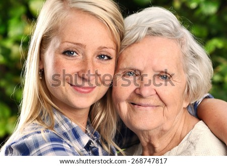 Grandmother and granddaughter. Young woman takes care of an elderly woman. MANY OTHER PHOTOS FROM THIS SERIES IN MY PORTFOLIO.