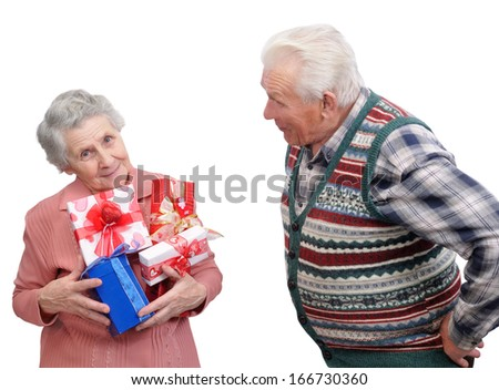 grandmother and grandfather together with gifts on white background  - stock photo