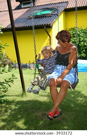 grandmother and grandson on swing
