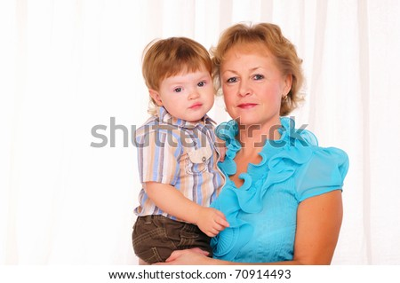 Grandmother and grandson spend time together. Symbol of the family. - stock photo