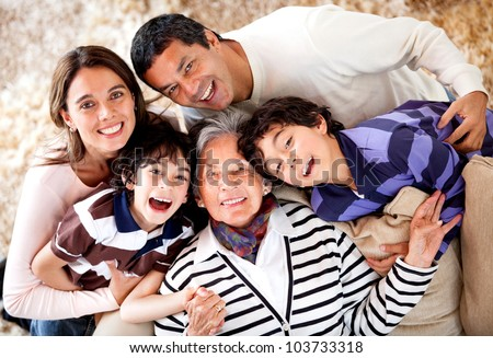 Grandmother and her family looking happy at home - stock photo