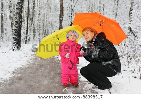 stock photo grandmother and little granddaughter with yellow and orange umbrella stand in woods in snow 88398517 - Tips on how to Spice Up Your Marriage: 9 Tips for a good Happy Matrimony