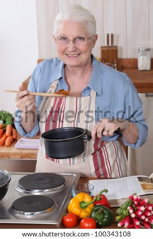 Grandmother cooking. - stock photo