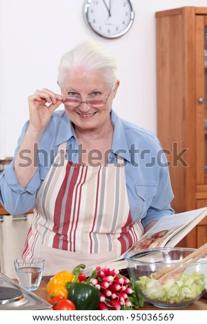 grandmother cooking in the kitchen - stock photo