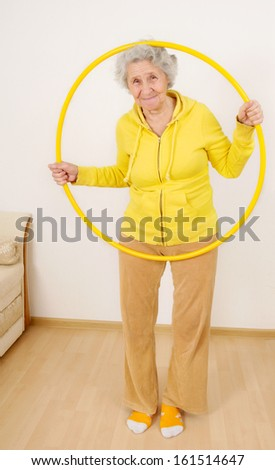 grandmother gymnastic exercises with hoop