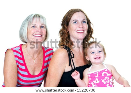 Grandmother, her daughter and her granddaughter with big smiles on their faces - stock photo