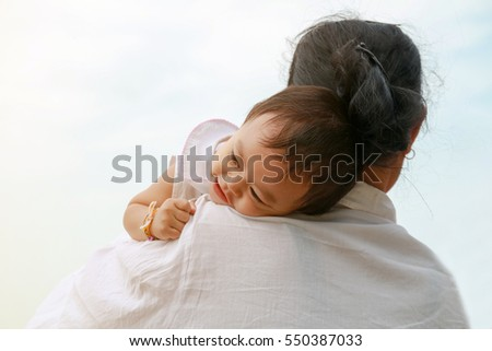Grandmother holding her baby granddaughter