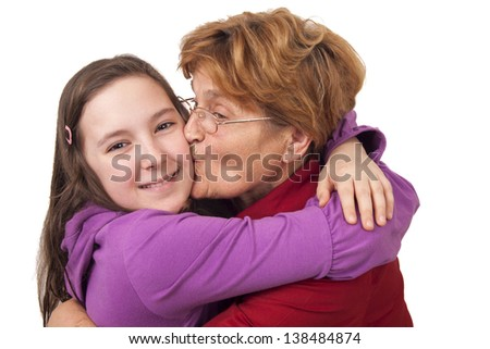 Grandmother kissing granddaughter Isolated on white background