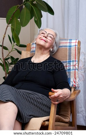 Grandmother portrait in her chair - stock photo
