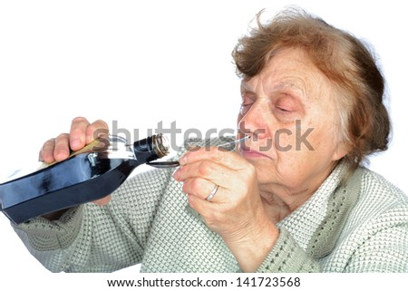 grandmother pours a medicine in  spoon isolated on  white background