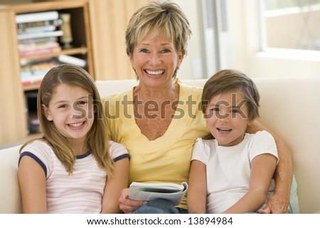 Grandmother reading with grandchildren - stock photo