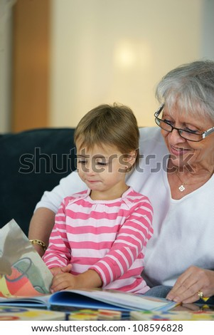 grandmother taking care of her granddaughter - stock photo