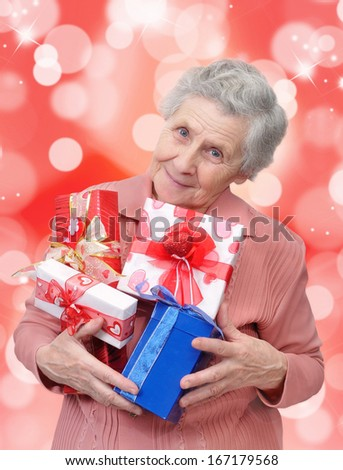 grandmother with gifts looking at the camera - stock photo