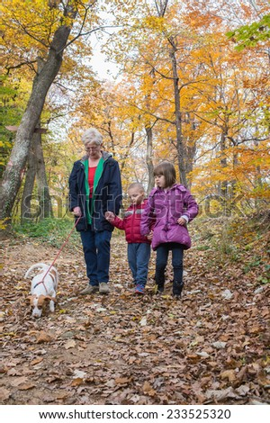 Grandmother with grandchildren on walk In forest