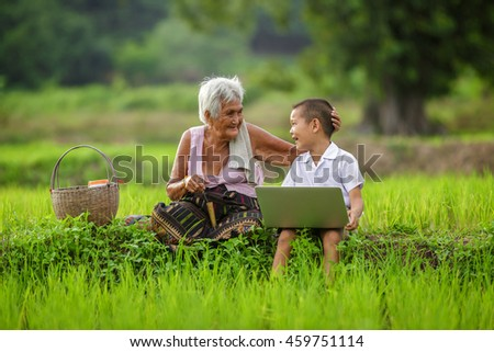 grandmother with grandchildren play computer, asia - stock photo
