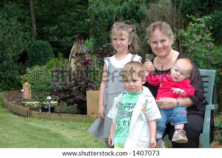 Grandmother with her grandchildren. Growth, generation concept. - stock photo