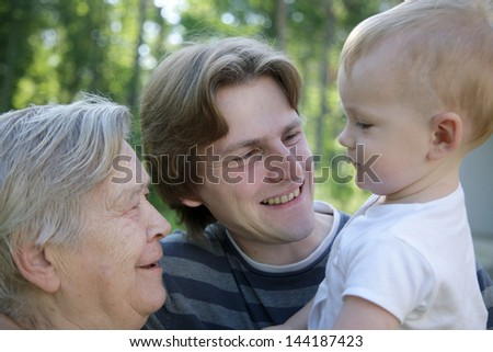 Grandmother with her son and grandchild