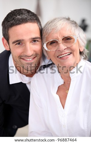 Grandmother with son - stock photo
