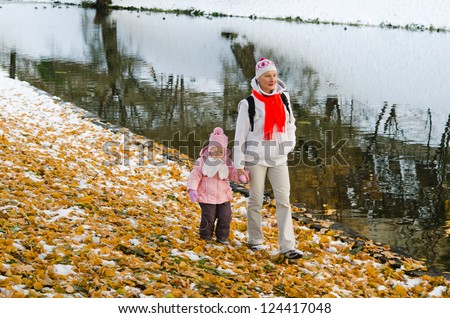 grandmother with the grand daughter in autumn park - stock photo