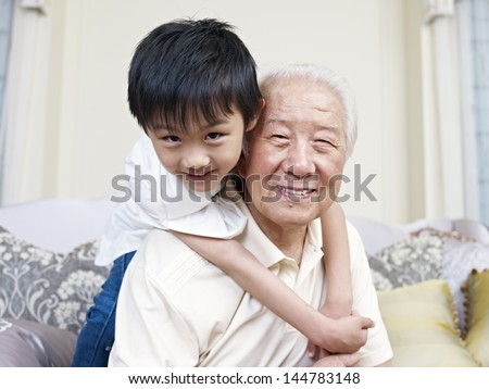 grandpa and grandson having fun at home. - stock photo